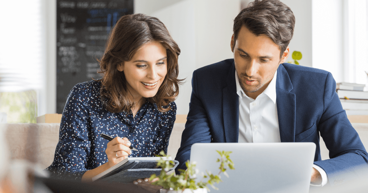 Man and woman work in front of laptop